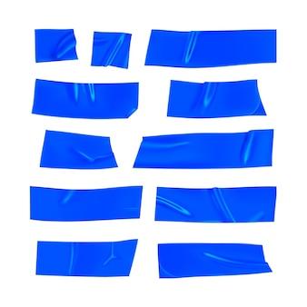 Blaues klebeband-set. realistische blaue klebebandstücke zur befestigung isoliert