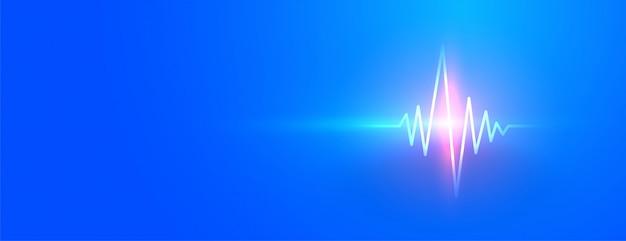 Blaues medizinisches banner mit leuchtender herzschlaglinie