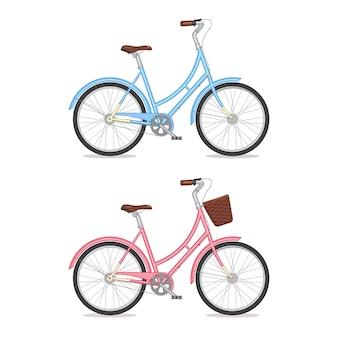 Blaues und rosafarbenes retro- fahrrad mit dem korb lokalisiert auf weißem hintergrund. buntes fahrrad
