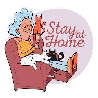 Bleib zuhause. frau trinkt wein, der mit ihren katzen sitzt