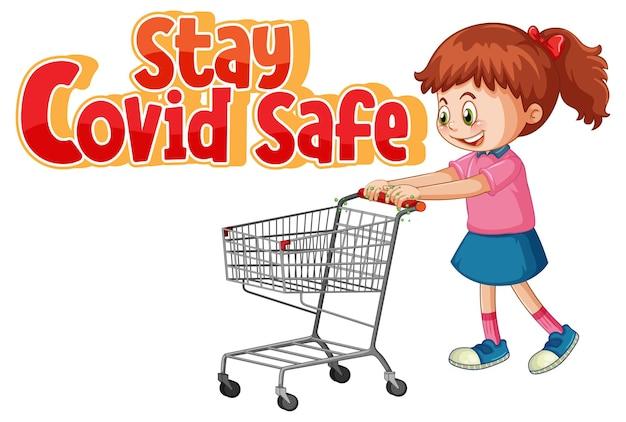 Bleiben sie covid safe schriftart im cartoon-stil mit einem mädchen, das am einkaufswagen steht, isoliert auf weißem hintergrund