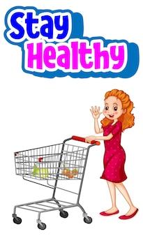 Bleiben sie gesund schriftart mit einer frau, die mit isoliertem einkaufswagen steht