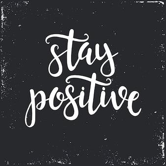 Bleiben sie positiv handgezeichnete typografie
