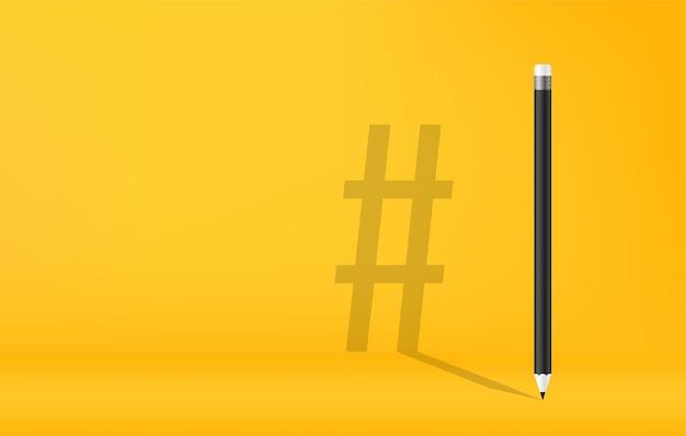 Bleistift mit hashtag-symbolschatten auf gelbem hintergrund