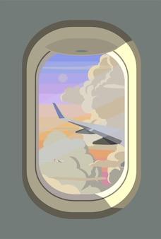 Blick auf die wolken aus dem flugzeugfenster.