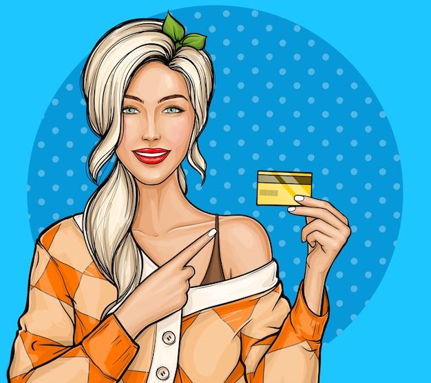 Blondes mädchen, das plastikkreditkarte in der hand im pop-art-stil hält