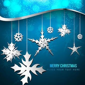 Blue christmas hintergrund mit schneeflocken