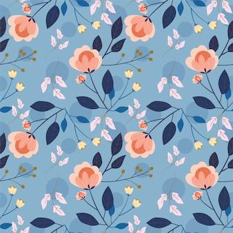 Blume und blätter auf nahtlosem muster des blauen hintergrundes