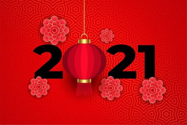 Blumen und laterne auf traditionellem chinesischem rot 2021