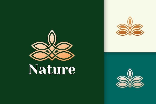 Blumenlogo im femininen und luxuriösen stil für gesundheit und schönheit