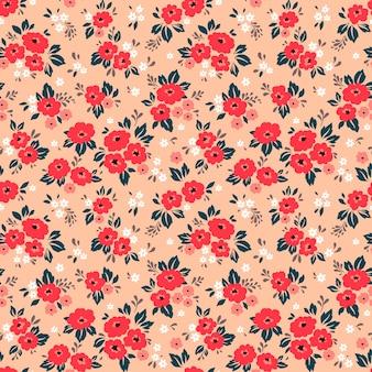 Blumenmuster. hübsche blumen, korallenhintergrund. drucken mit kleinen roten blüten. ditsy drucken