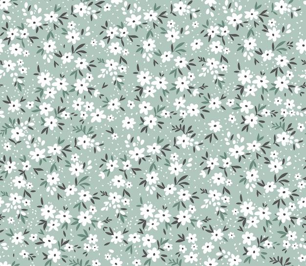 Blumenmuster süße blumen hellblauer hintergrund design mit kleinen weißen blumen ditsy print