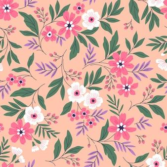Blumenmuster süße blumen hellkorallenroter hintergrund design mit kleinen pastellfarbenen blumen ditsy-druck