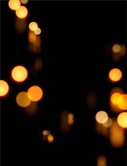 Bokeh glühender hintergrund mit warmer orange farbe