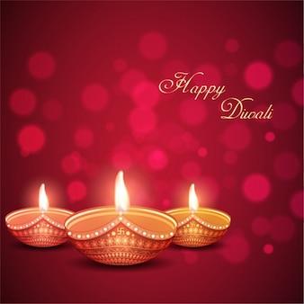 Bokeh hintergrund mit drei dekorative kerzen für diwali