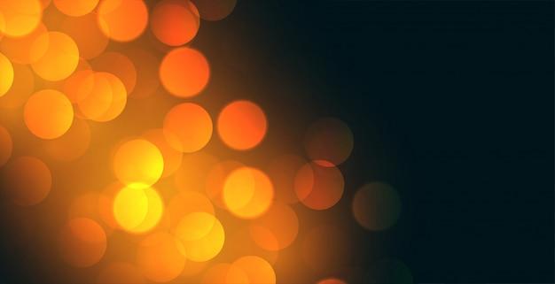 Bokeh hintergrunddesign mit gelbem lichteffekt