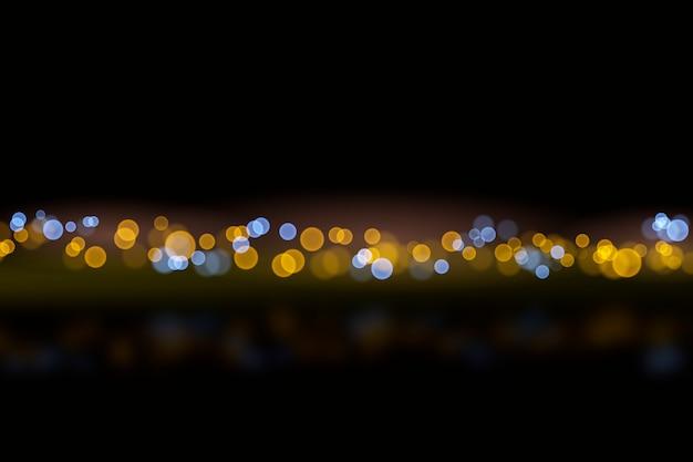 Bokeh-lichteffekt auf dunkle hintergrundart