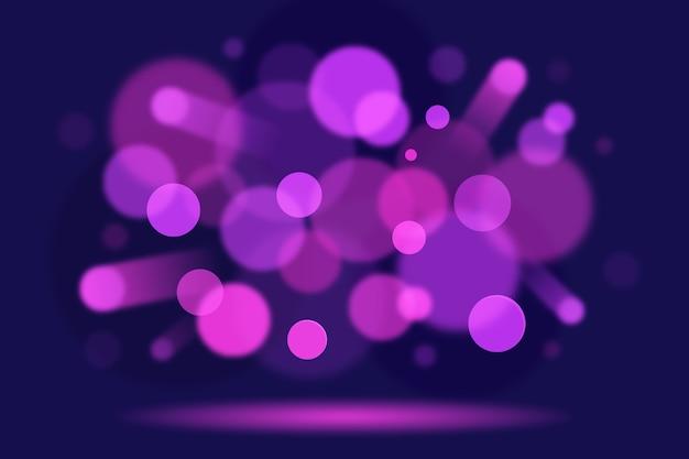 Bokeh-lichteffekt auf dunklem hintergrunddesign