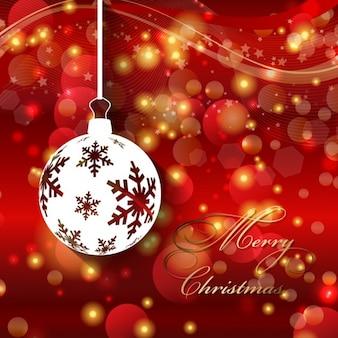 Bokeh weihnachtskarte mit weißen christbaumkugel