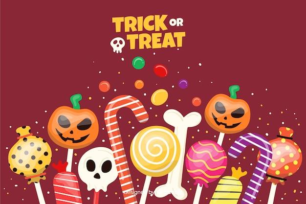 Bonbons auf flachem halloween-hintergrund