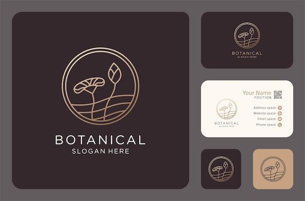 Botanisches logo mit visitenkartendesign in goldener farbe.