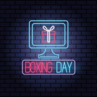 Boxing day sale neonlichter mit desktop und geschenk vektor-illustration design