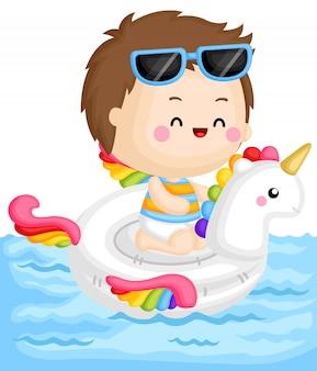 Boy on unicorn float