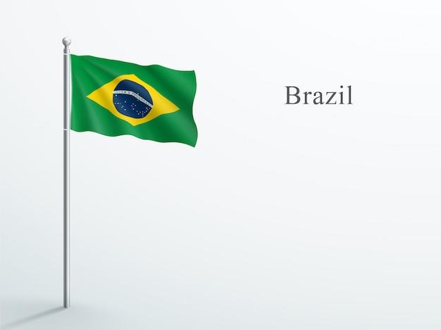 Brasilien-flagge 3d element, das auf stahlfahnenmast winkt