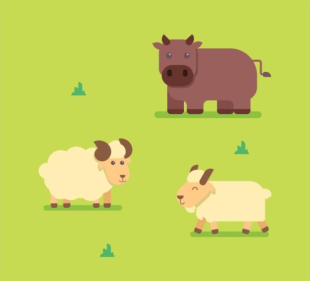 Braune kuh und weiße schafe und ziege, die auf gras stehen