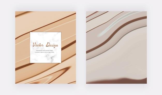 Braune und graue flüssige tintenkarten und marmorrahmen.