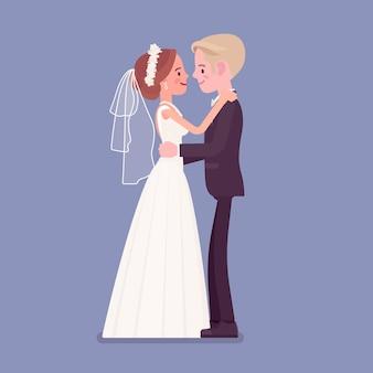 Braut und bräutigam in sanfter umarmung bei der hochzeitszeremonie