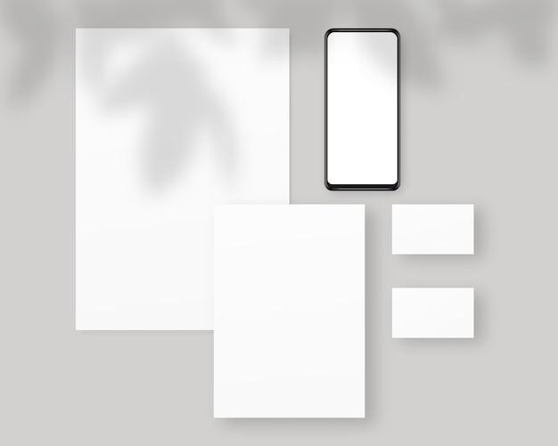 Briefpapier mit papieren, visitenkarten, smartphone. briefpapier mit schattenüberlagerungen. branding schreibwaren szene. corporate identity design.