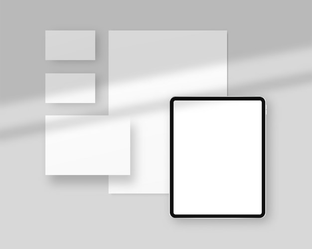Briefpapierschablone mit schattenüberlagerungen. briefpapier mit papieren, visitenkarten, tablette. branding schreibwaren szene. corporate identity design.