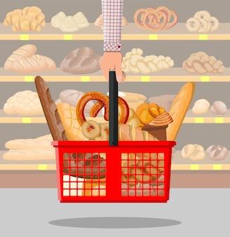 Brotprodukte im einkaufskorb in der hand