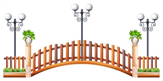 Brücke mit holzzaun und lampe