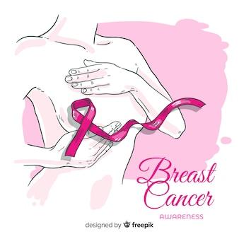 Brustkrebsbewusstsein mit gezeichnetem design des bandes in der hand
