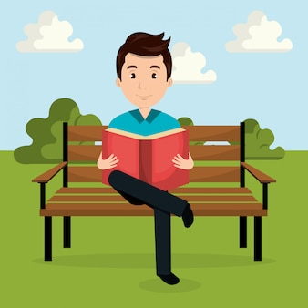 Buch des jungen mannes lesein dem parkcharakter