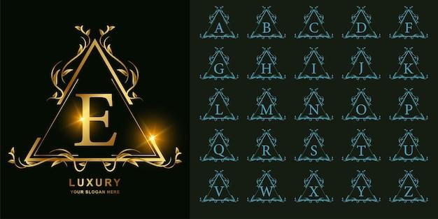 Buchstabe e oder sammlungsanfangsalphabet mit goldener logoschablone des luxuriösen ornamentblumenrahmens.