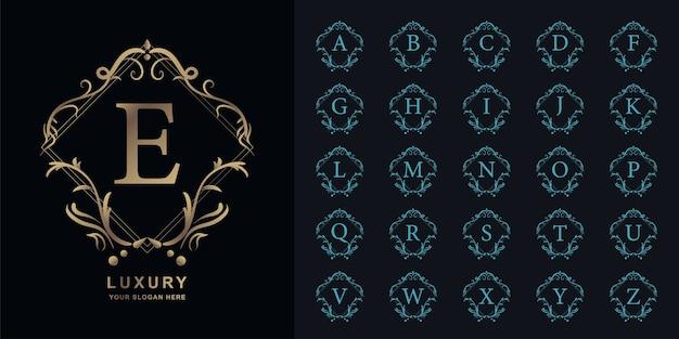 Buchstabe e oder sammlungsinitialalphabet mit goldener logo-schablone des luxusornamentblumenrahmens.
