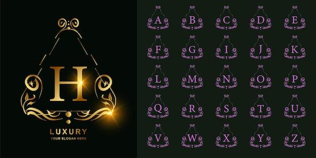 Buchstabe h oder sammlungsanfangsalphabet mit goldener logoschablone des luxuriösen ornamentblumenrahmens.
