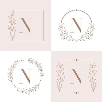 Buchstabe n-logo mit blumenrahmenhintergrundschablone
