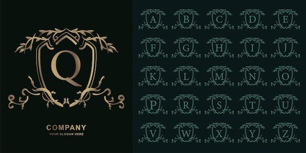 Buchstabe q oder sammlungsanfangsalphabet mit goldener logoschablone des luxuriösen ornamentblumenrahmens.