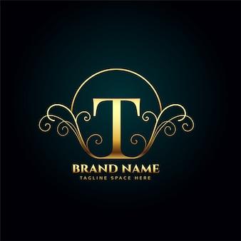 Buchstabe t logo monogramm im goldenen luxusstil