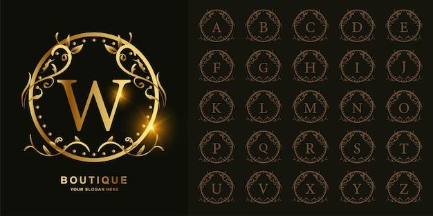 Buchstabe w oder sammlungsanfangsalphabet mit goldener logo-schablone des luxusverzierungsblumenrahmens.
