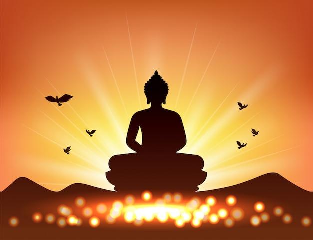 Buddha silhouette und kerzenlicht für den buddhismus