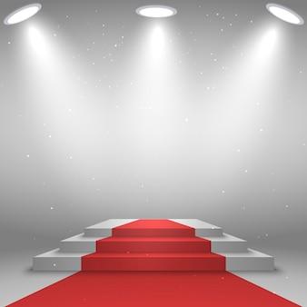 Bühne für siegerehrung. weißes podium mit rotem teppich, beleuchtet durch scheinwerfer