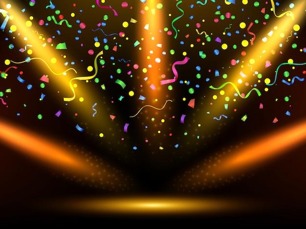 Bühne mit bunten gelben lichtern. feier. serpentin und konfetti.