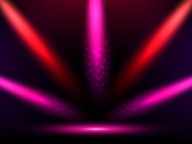 Bühne mit bunten roten und rosa lichtern.