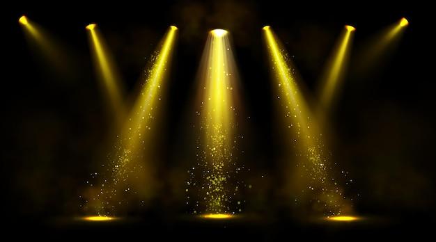 Bühnenlichter, goldene scheinwerfer mit rauch und funkeln.