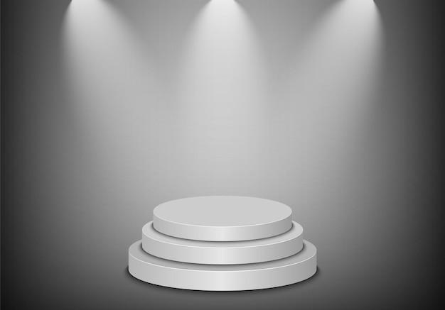 Bühnenpodest mit beleuchtung auf grauem hintergrund